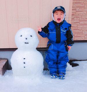 僕と雪だるまの写真・画像素材[1671936]