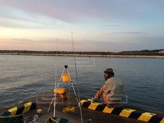 海,朝焼け,後姿,釣り
