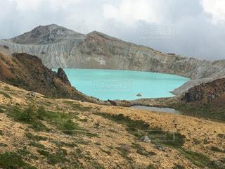 背景の山と水体の写真・画像素材[720670]