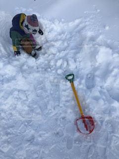 雪をスノーボードに乗る人が斜面をカバーの写真・画像素材[1662941]