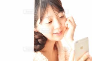 自分撮りをする女性の写真・画像素材[2299807]