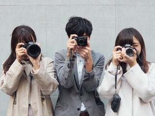 カメラ男子とカメラ女子の写真・画像素材[1828832]