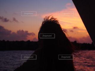 夕陽と私の写真・画像素材[1271963]