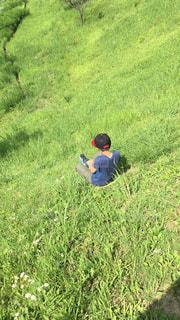緑の草原の人の写真・画像素材[1173660]