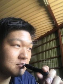 彼の歯を磨く男の写真・画像素材[709416]