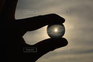 夕日,ガラス玉,一眼レフ,ジェスチャー
