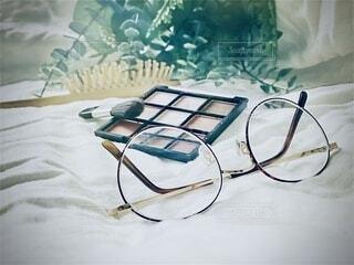 コスメと眼鏡の写真・画像素材[3762551]