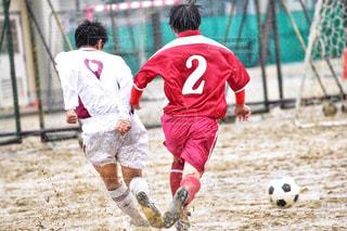 サッカーのゲームの若い男性のグループの写真・画像素材[1318533]