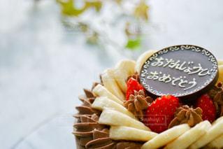スイーツ,ケーキ,文字,赤,いちご,洋菓子,チョコレート,メッセージ,誕生日,チョコレートケーキ,手作り,手書き,茶,プレート,お誕生日,バースデーケーキ,日本語,イチゴ,デコレーションケーキ,バナナ,おたんじょうびおめでとう,ひらがな,手書きメッセージ,手書き文字