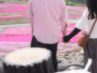 ケーキの前に立っている人の写真・画像素材[3259379]