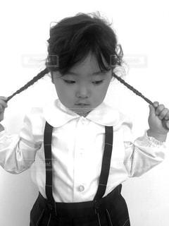 みつあみした女の子の写真・画像素材[839573]