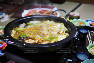 テーブルの上に食べ物のボウルの写真・画像素材[789612]