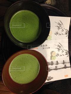 テーブルの上のコーヒー カップの写真・画像素材[929079]