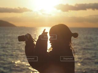 夕日が眩しいの写真・画像素材[1261052]