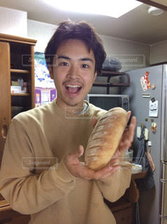 ホットドッグを食べる人の写真・画像素材[1567869]