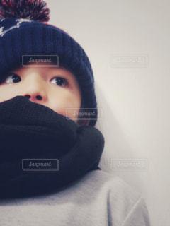 帽子をかぶった小さな男の子の写真・画像素材[880922]