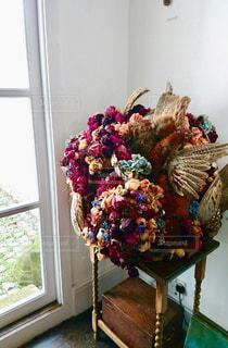 花,フラワーアレンジメント,花と羽