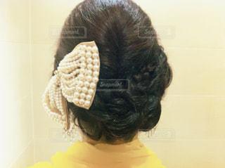結婚式お呼ばれヘアーの写真・画像素材[1029027]