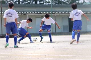 子ども,サッカーボール,サッカー,こども,男の子,大会,部活,汗,トレーリング