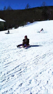 雪をスノーボードに乗る人が斜面をカバーの写真・画像素材[1727164]