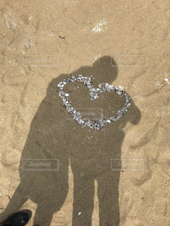 カフェ,カップル,ビーチ,砂浜,海辺,貝殻,アート,影,オシャレ,人,福岡,デート,お揃い,プライベート,彼女