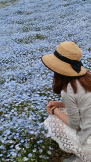 花畑と麦わら帽子と私の写真・画像素材[889064]