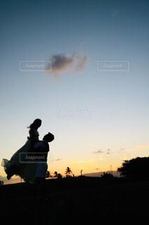 ハワイの夕陽に見守られての写真・画像素材[1227901]