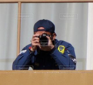 見てる人の写真・画像素材[1201191]