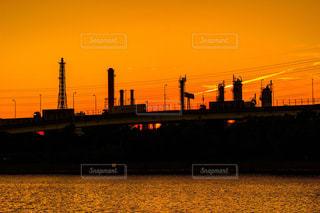 風景,夕日,夕焼け,水面,工場,工事夜景