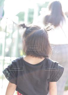 ツヤ髪アレンジの写真・画像素材[2482309]