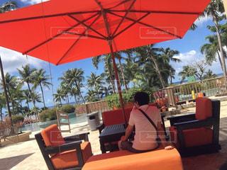 傘,屋外,海外,晴れ,青空,アメリカ,オレンジ,椅子,樹木,旅行,ヤシの木,グアム,リゾート,GUAM,眺め,おしゃれ