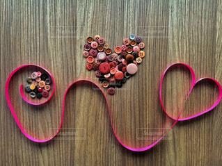 ピンク リボンとハートの写真・画像素材[999623]