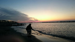 海,空,砂浜,夕暮れ,休日,染まる