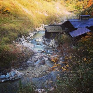 川辺の温泉♨️の写真・画像素材[1017005]