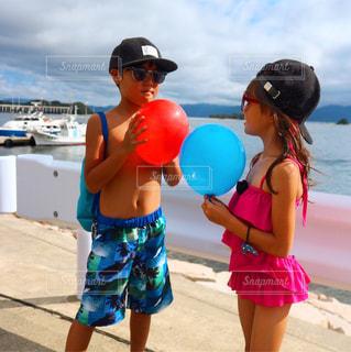 少年と女子の夏休みの写真・画像素材[1025689]