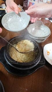 鍋,ご飯,焼肉,飲み会,宴会,韓国料理,忘年会,シメ,おじや,わいわい,食欲,雑炊,アワビの雑炊