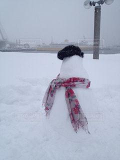 青森に行った時、雪がたくさんで楽しくなって雪だるまを作りましたの写真・画像素材[1806129]