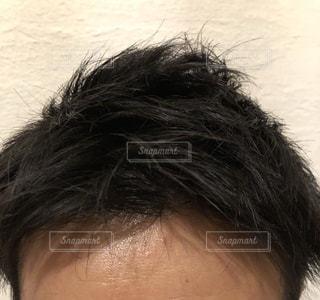 男性の無造作ヘア(短髪)の写真・画像素材[1050360]