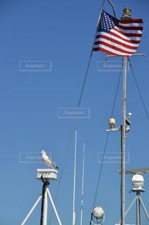 青空と国旗の写真・画像素材[1096740]