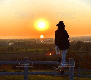 女性,空,夕日,綺麗,北海道,観光,旅行