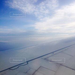雲の上からの青空の写真・画像素材[1099340]