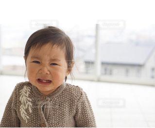 カメラに向かって笑みを浮かべて少女の写真・画像素材[1788921]