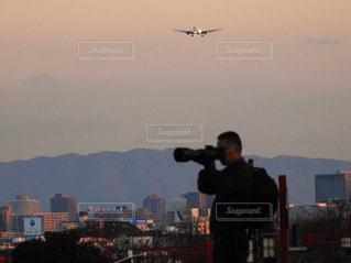 カメラマンと飛行機の写真・画像素材[1694943]