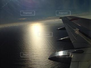 海,空,夏,夕日,飛行機,光の道
