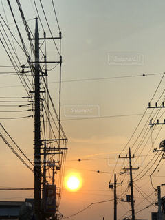 夕日,太陽,夕暮れ,街,電線,電信柱,茨城県