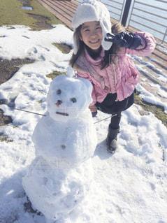 雪だるまと記念写真の写真・画像素材[1700663]