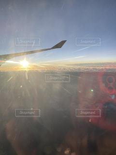 飛行機からの朝日の写真・画像素材[2859020]