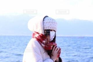 帽子と水の体を身に着けている人の写真・画像素材[4134453]
