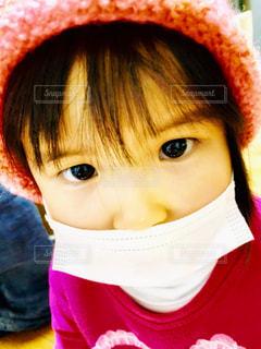 近くに帽子をかぶっている女の子のの写真・画像素材[1700155]
