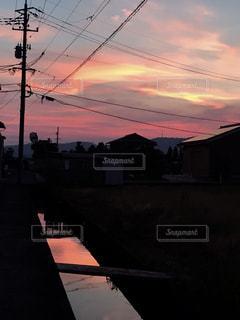 風景,ピンク,夕焼け,川,町並み,ピンク色,桃色